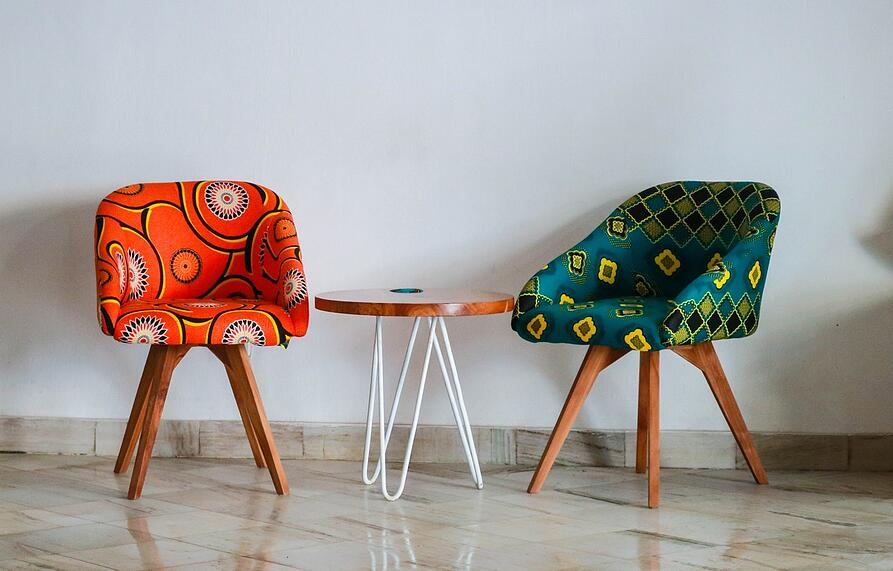 two-assorted-color-padded-chairs-near-side-table-1350789